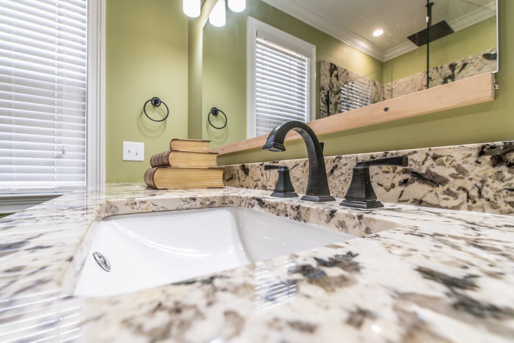 Bathroom Remodel   Granite Counter With Backsplash And Bathroom Accessories  With Sink Close Up
