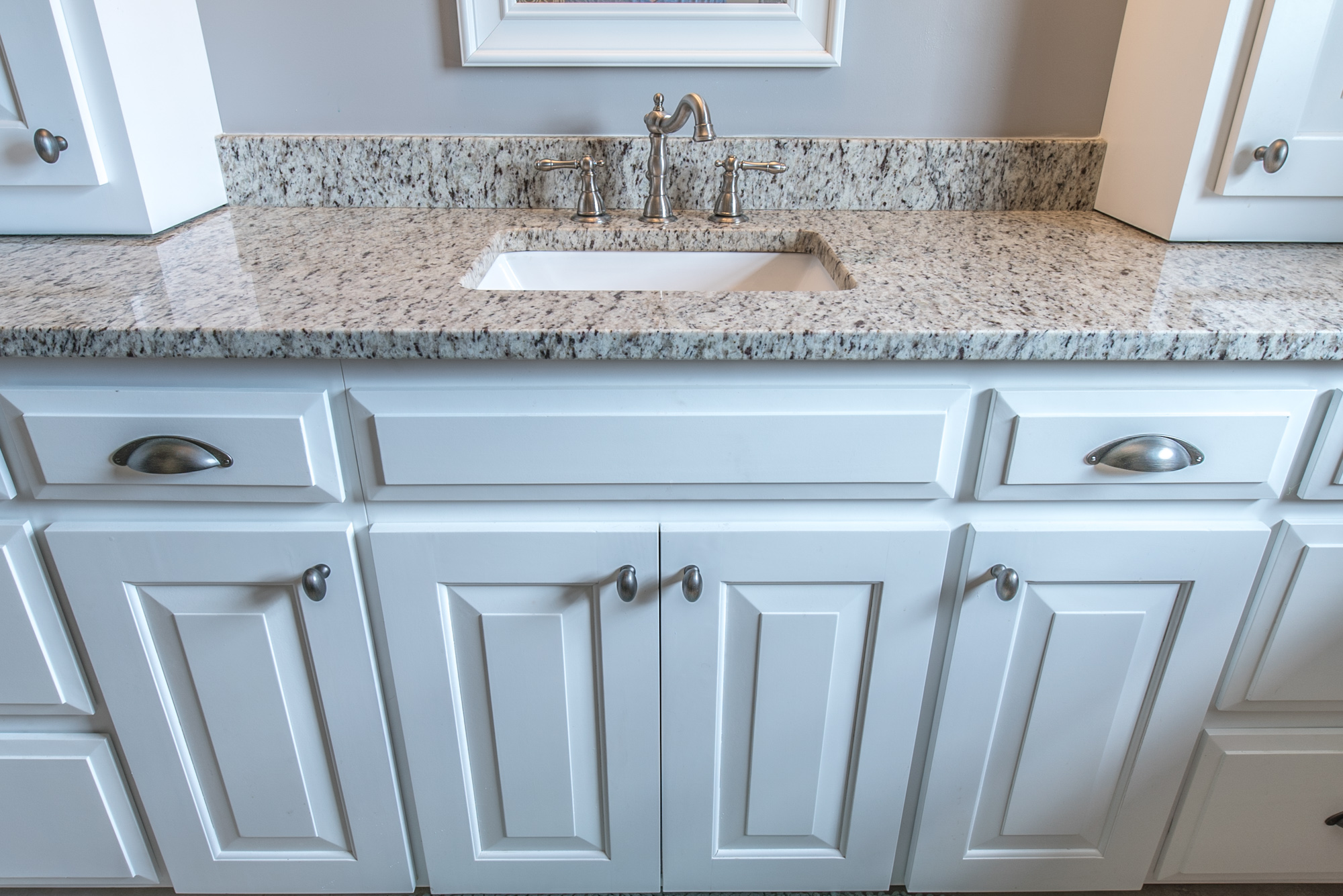 Bathroom Remodel - Granite counter with backsplash and white cabinets