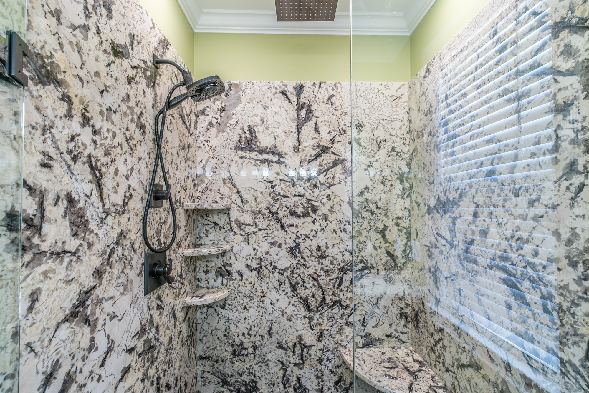 Bathroom Remodel - Shower with marble tile walls and glass door