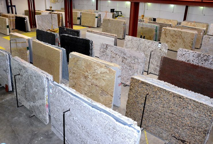 Indoor showroom with large inventory selection of granite slabs