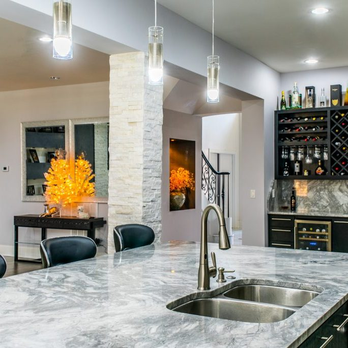 Marble kitchen island bar renovation by East Coast Granite