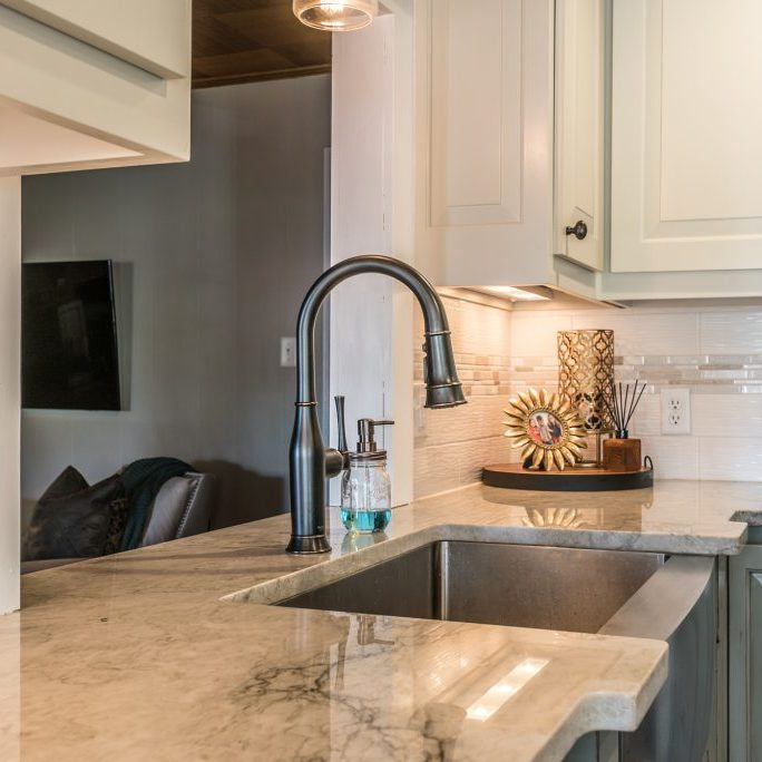 Quartz kitchen countertop with sink installed in East Coast Granite