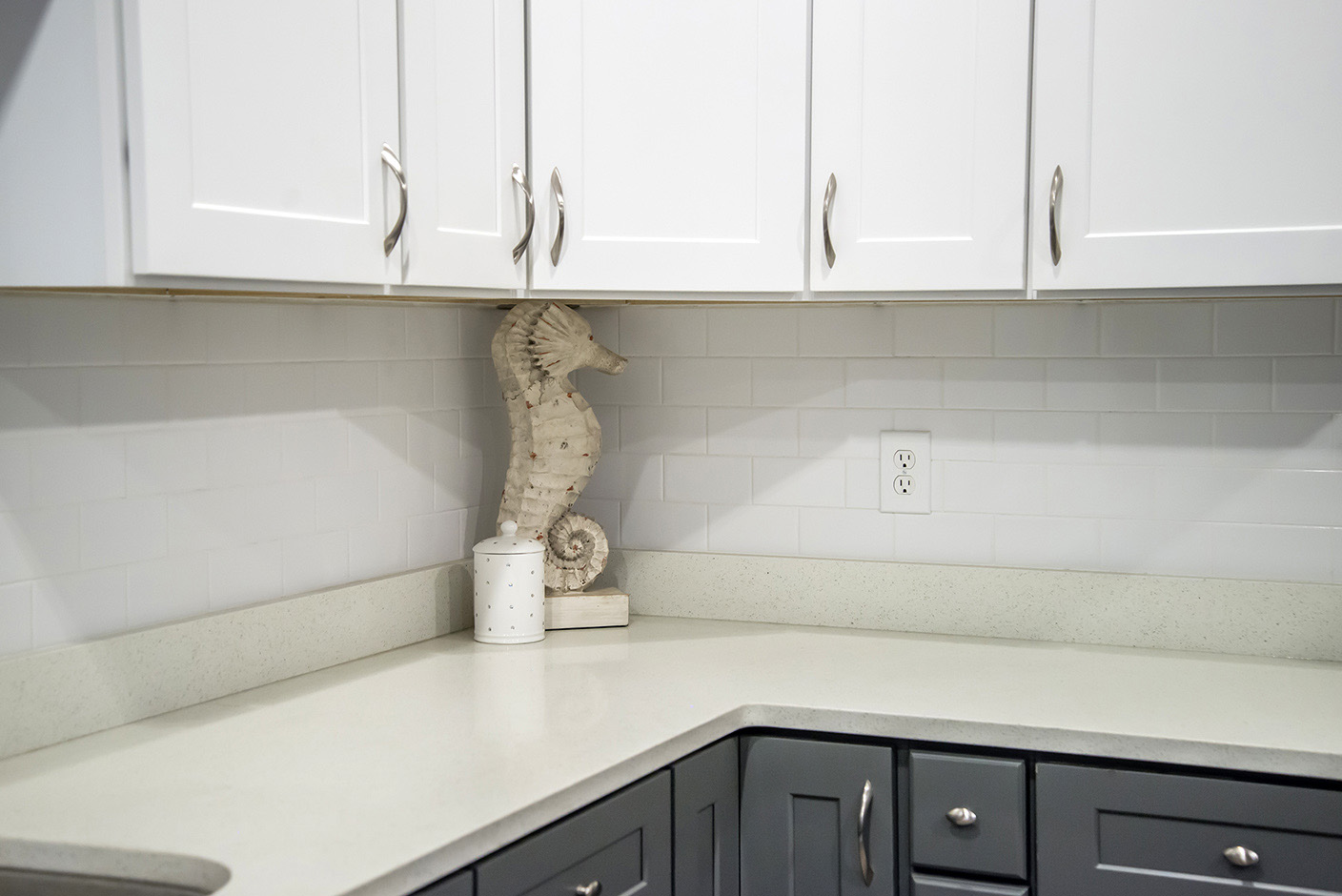 Beige Quartz Countertops White Subway Tile Backsplash Gray Base and White Upper Cabinets