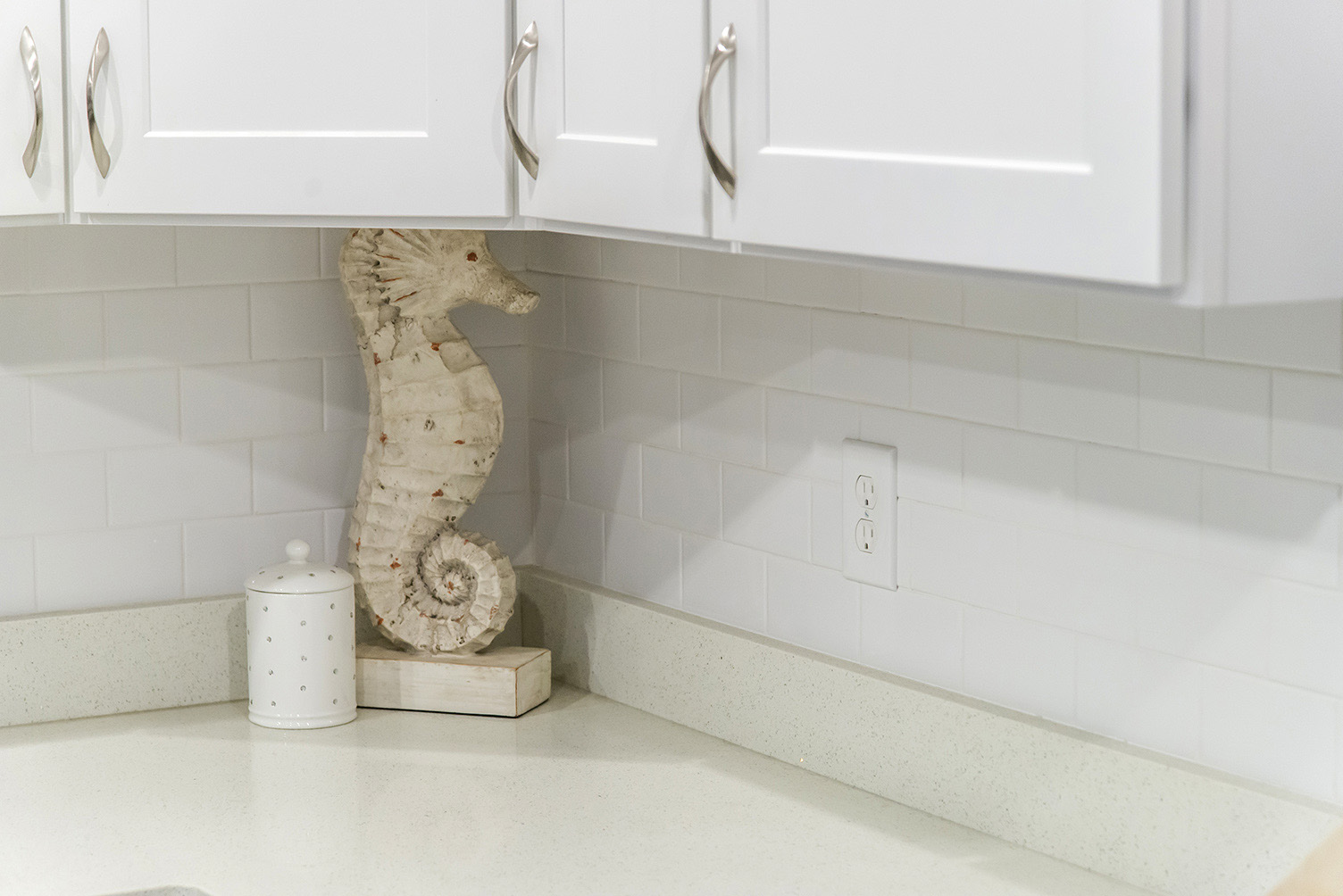 Beautiful Beige Quartz with White Subway Tile Backsplash