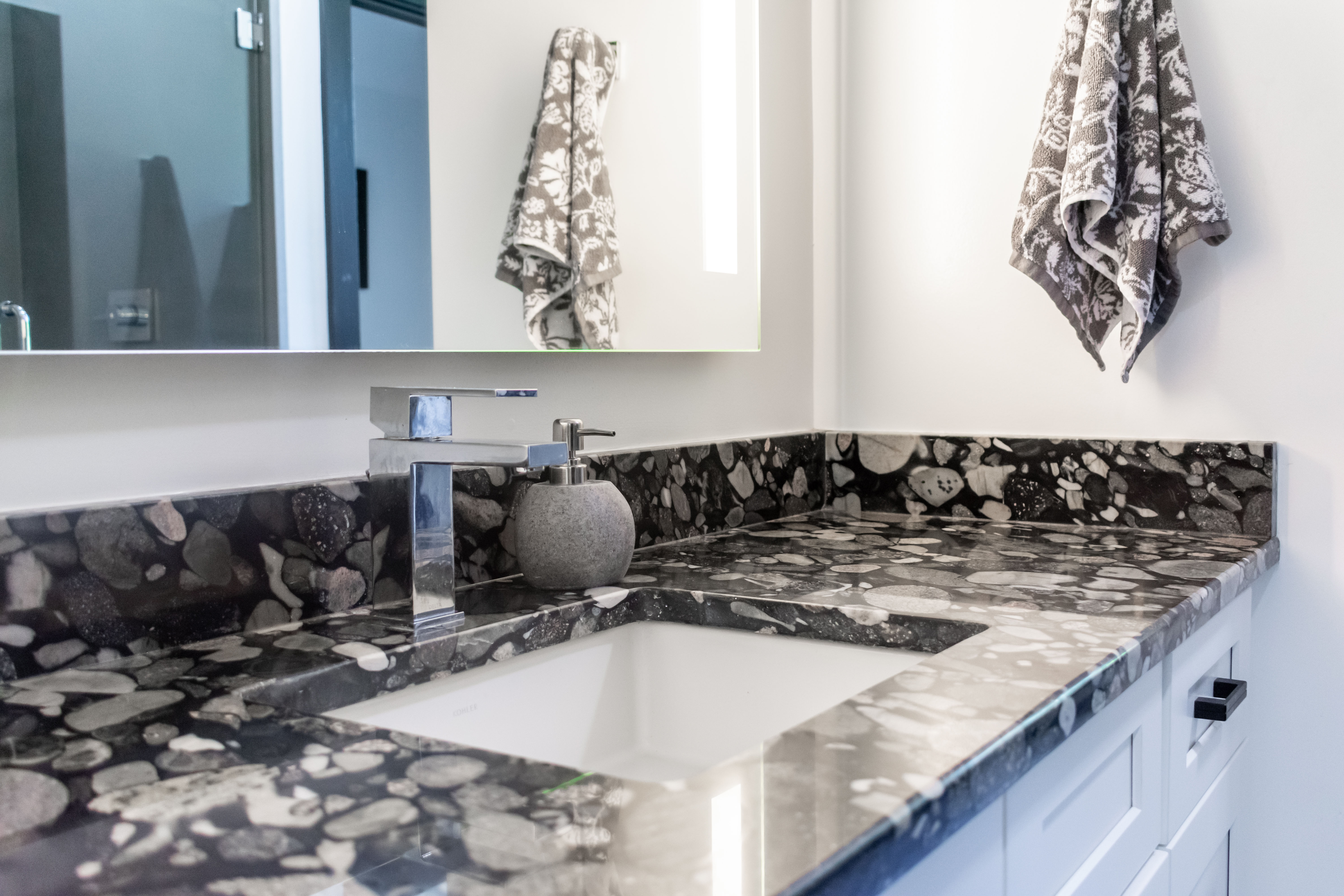 Black Mariachi Granite Vanity Top with White Cabinets