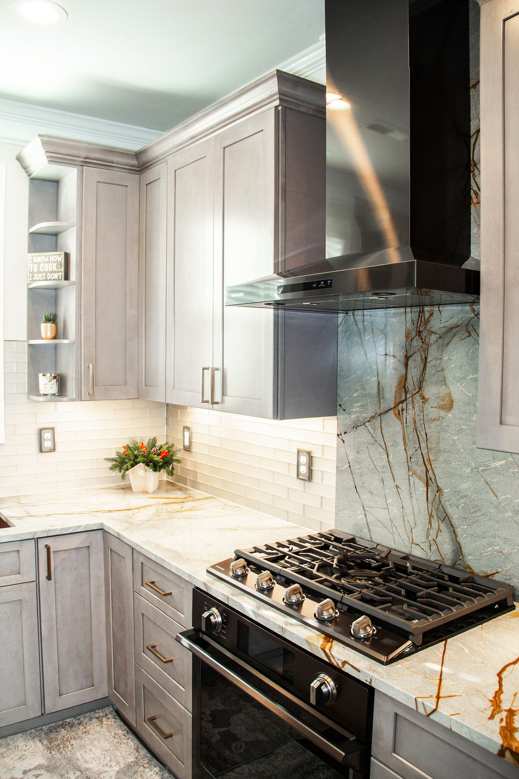 On this install we continue the beautiful Blue Roma quartzite up the backsplash to compliment the amazing subway tile backsplash.