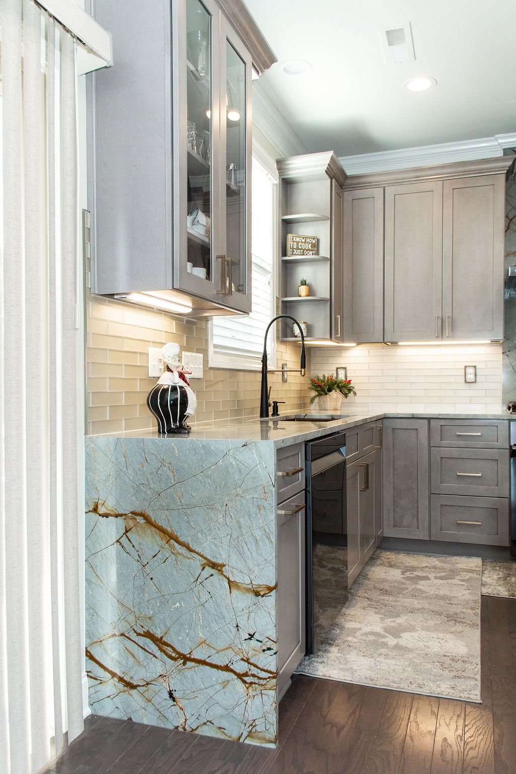 A custom waterfall edge with Blue Roma Quartzite