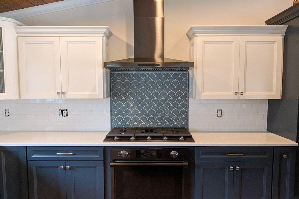 Blue Wave Tile Backsplash paired with White 3x6 Subway Tile