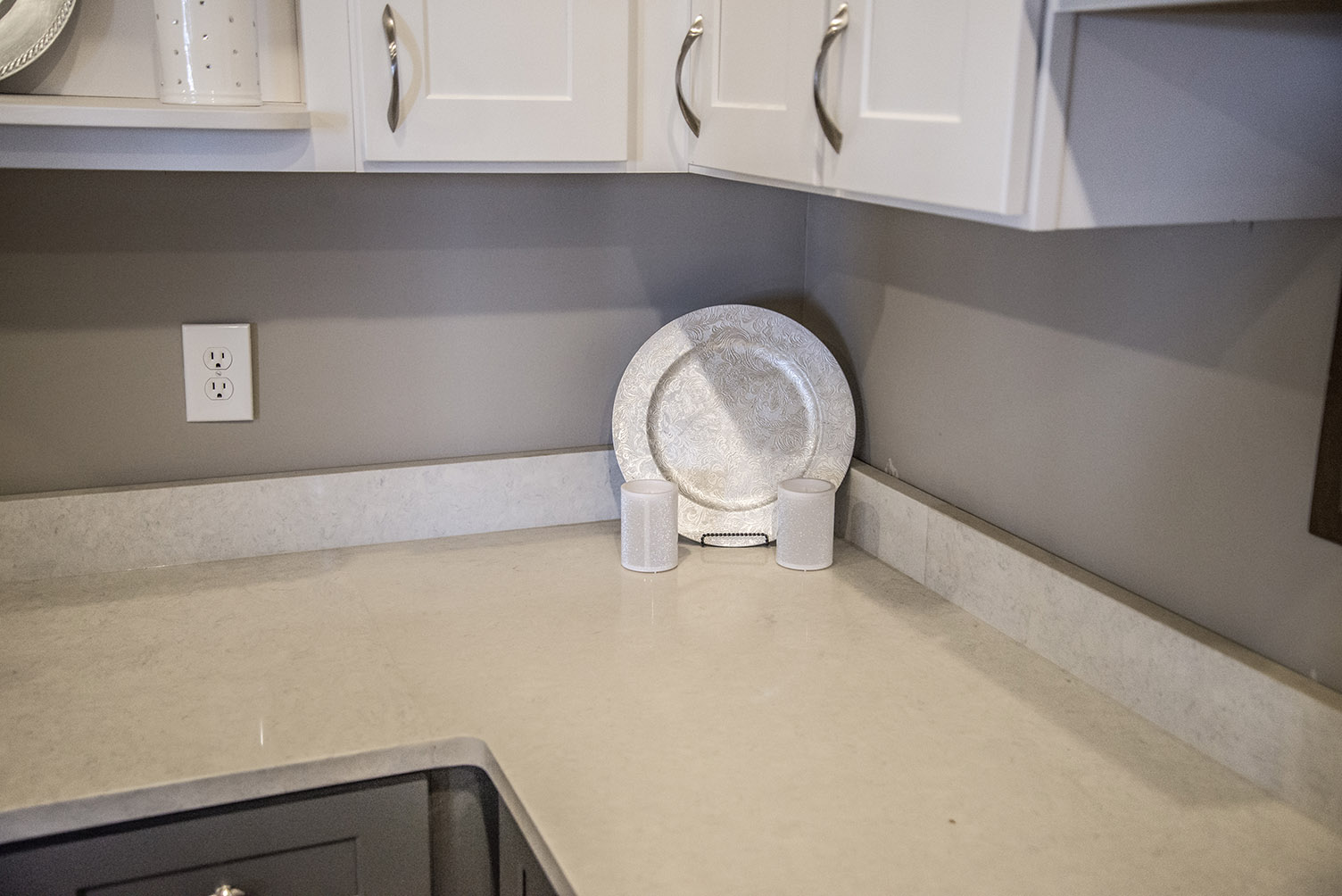Carrera Classic Quartz Countertops with Gray Base Cabinets & White Upper Cabinets