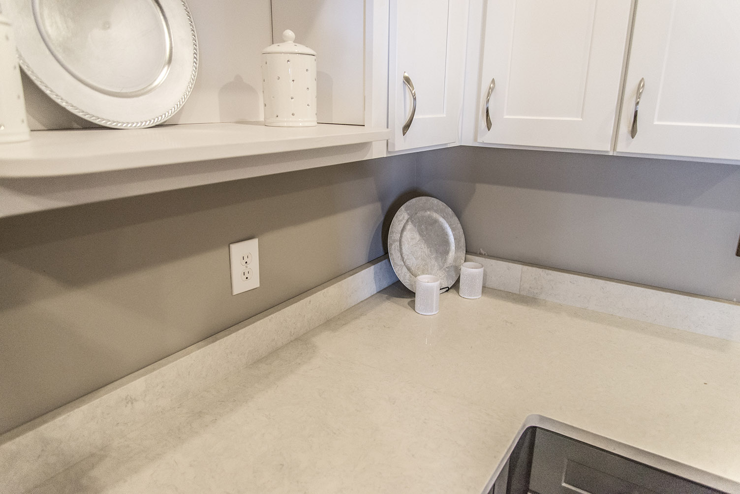Carrera Classic Quartz Countertops with Gray Base Cabinets & White Upper Cabinets and Open Shelving
