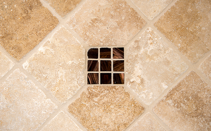 Classic Travertine tile with decorative glass tile inlays