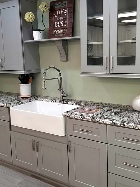 Granite countertops with farmhouse sink and shaker cabinets
