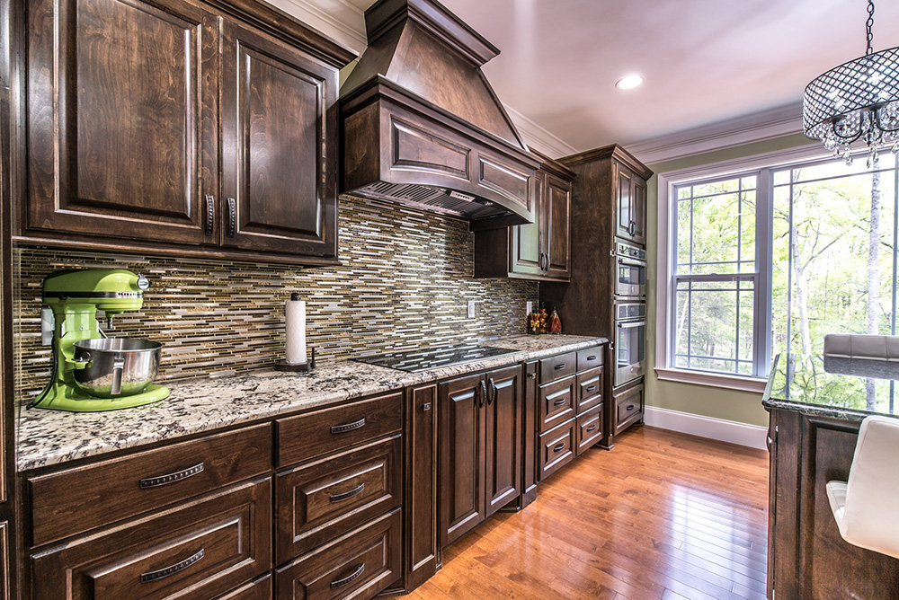 Delicatus White Granite Countertops Matched With Dark Brown Cabinets And Earth Toned Tile Backsplash