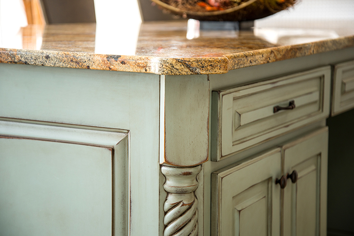 Spacious granite topped kitchen island with large storage compartments in a beautiful Tiffany Blue.