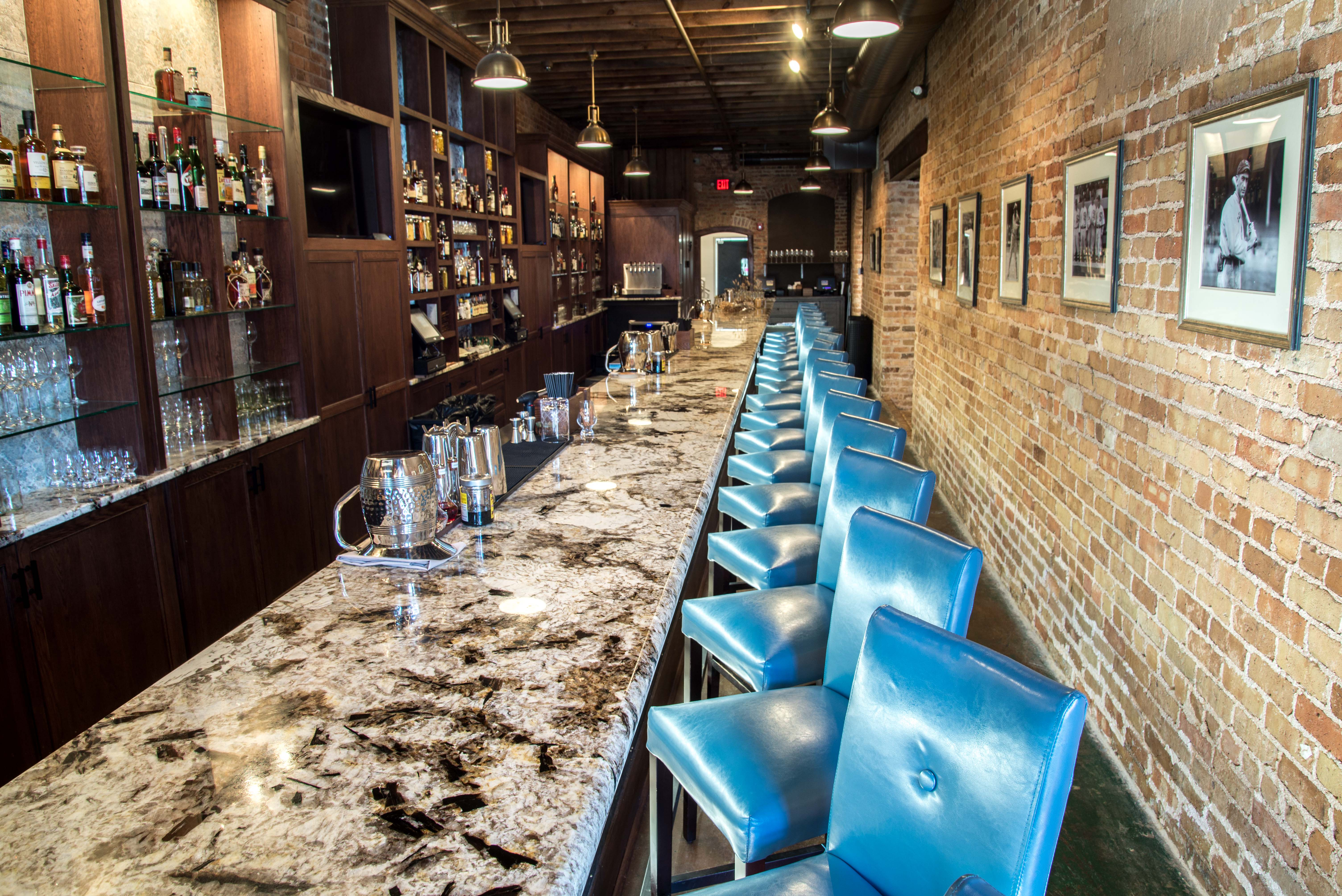 Granite Countertops used on the bar top at Husk a downtown Greenville, SC restaurant.  They chose a beautiful material called Copenhagen granite.