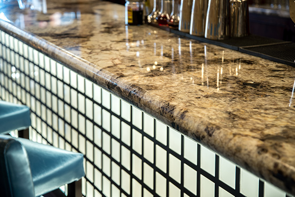 Copenhagen Granite Countertops with full bullnose edge used on the bar top at Husk a downtown Greenville, SC restaurant