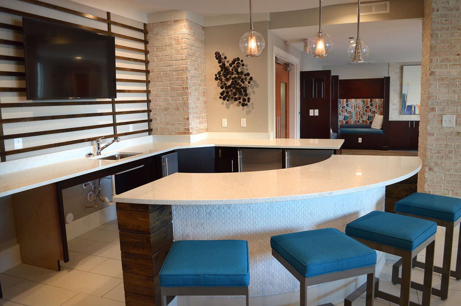 A perfect gathering area brought together by White quartz countertops and a beautiful tile bar front in the Link's commons area