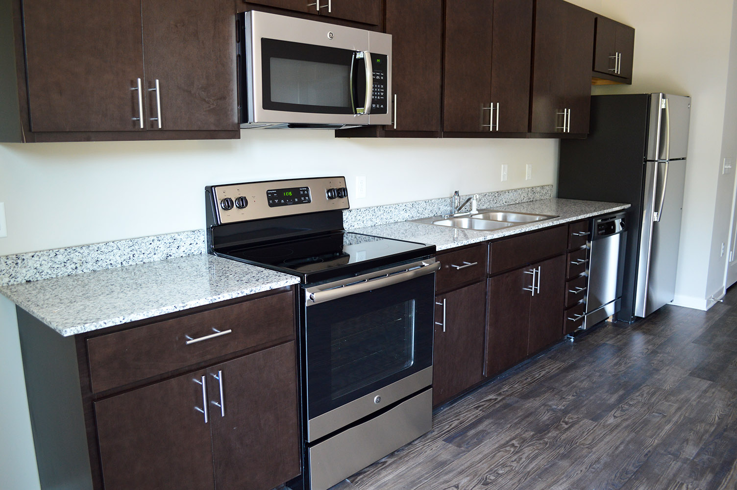 "Some of the apartments utilize a ""Pullman"" kitchen layout with granite countertops from East Coast Granite"
