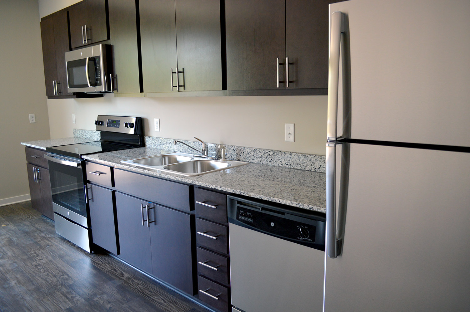 "Another view of the ""Pullman"" style kitchens with granite countertops used in some of the apartments at Main & Stone"