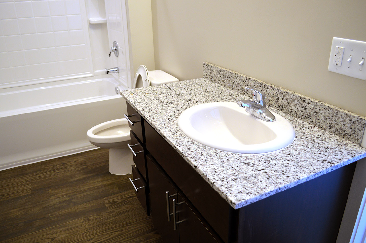 Bringing the same neat and clean feel from the granite countertops in the kitchen area to the bathroom vanities