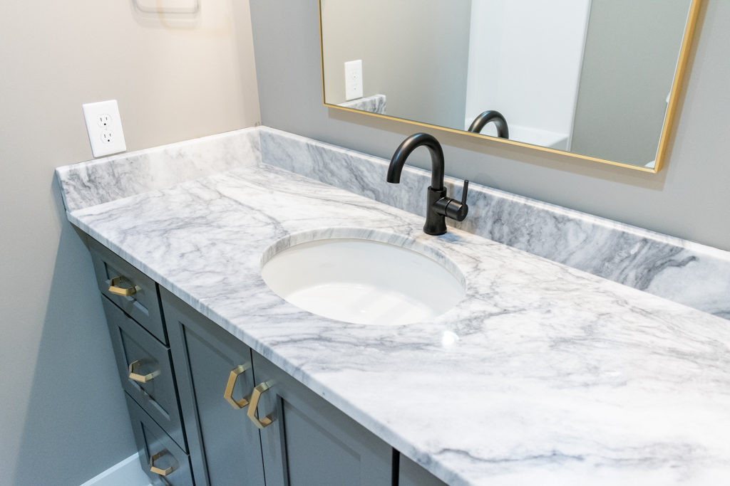 Spacious guest vanity topped with Mont Blanc Marble
