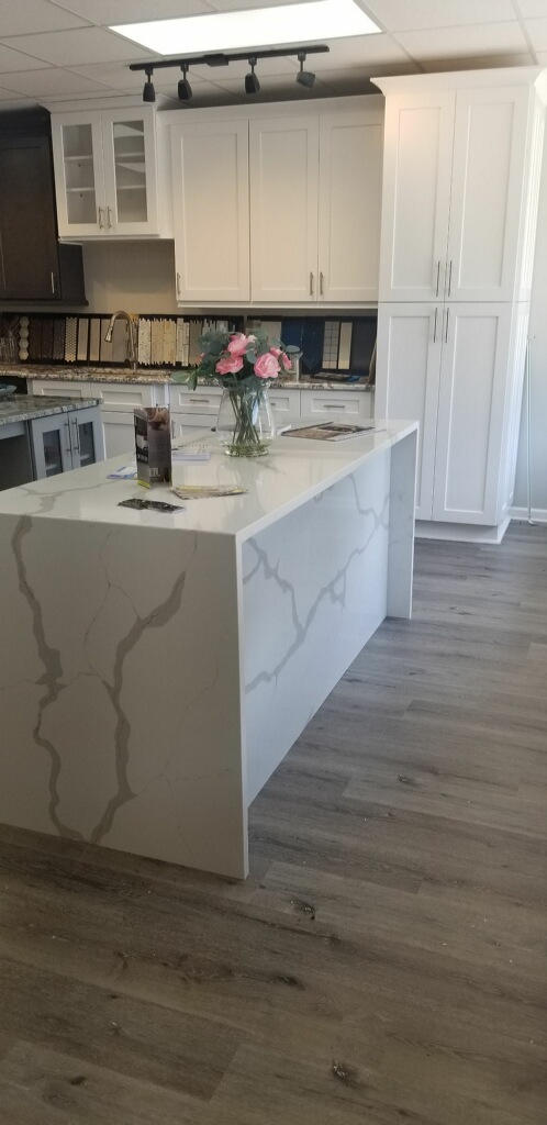 Our showroom is a great source of inspiration and ideas for your kitchen remodel. Here we have Calacatta Sponda quartz countertops with a waterfall edge.