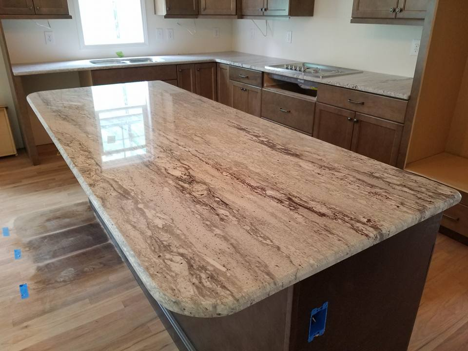 Kitchen Island Topped With River White Granite