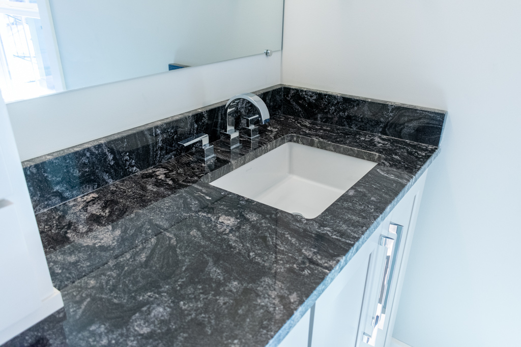 Master bathroom double vanity topped with Silver Waves granite