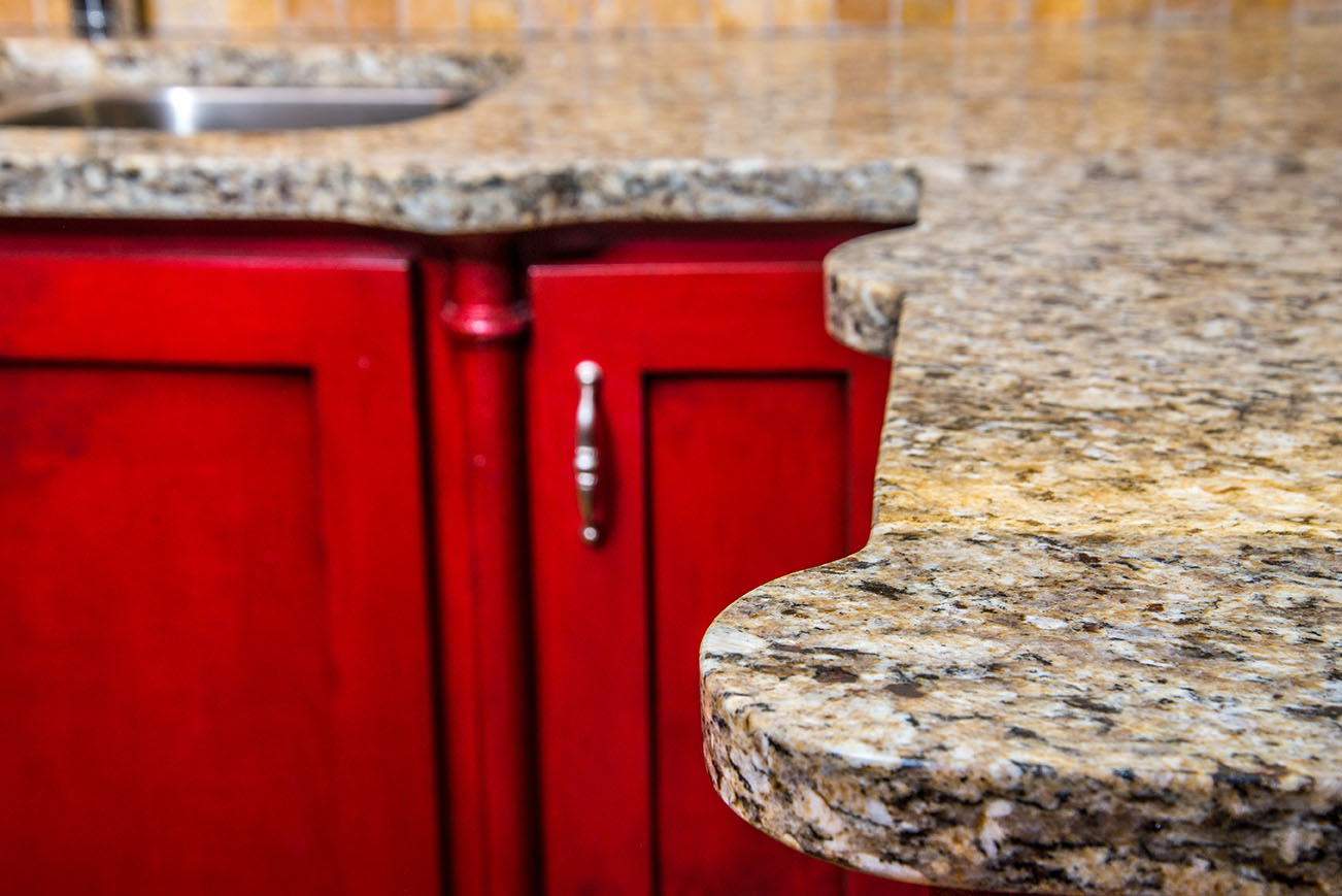 Saint Cecelia Granite Kitchen Countertops With Semi Circle Designed Edges