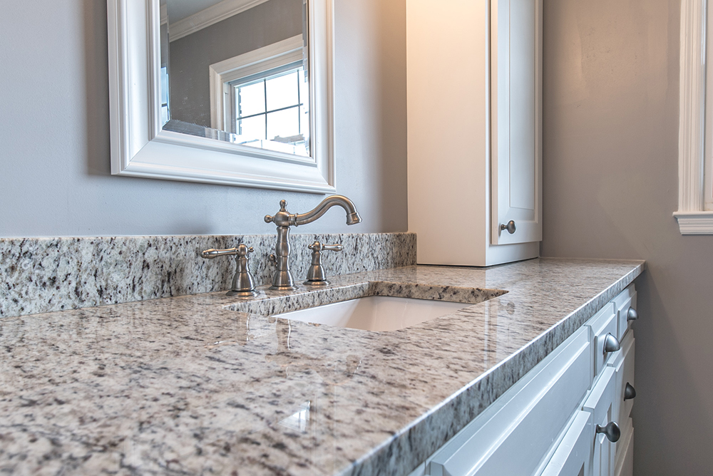 The neutral tones of Verona granite pair well with grays and whites of this bathroom