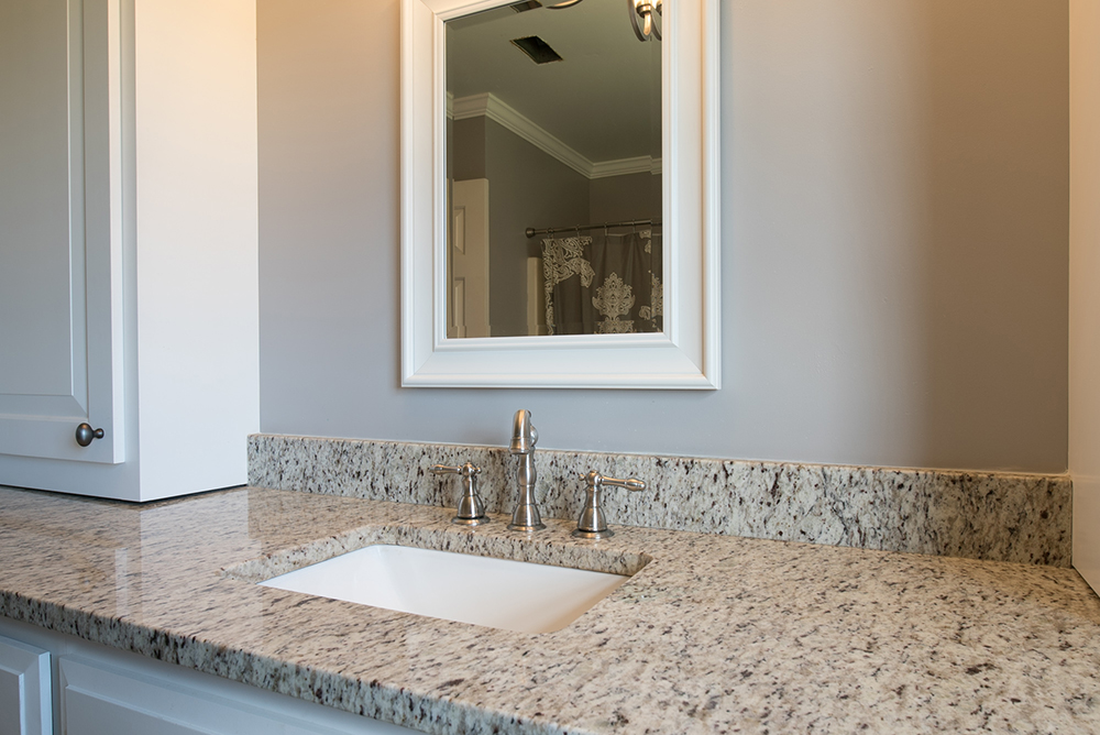 Verona granite vanity with White shaker cabinets, square bowl sink, Nickel finished faucet