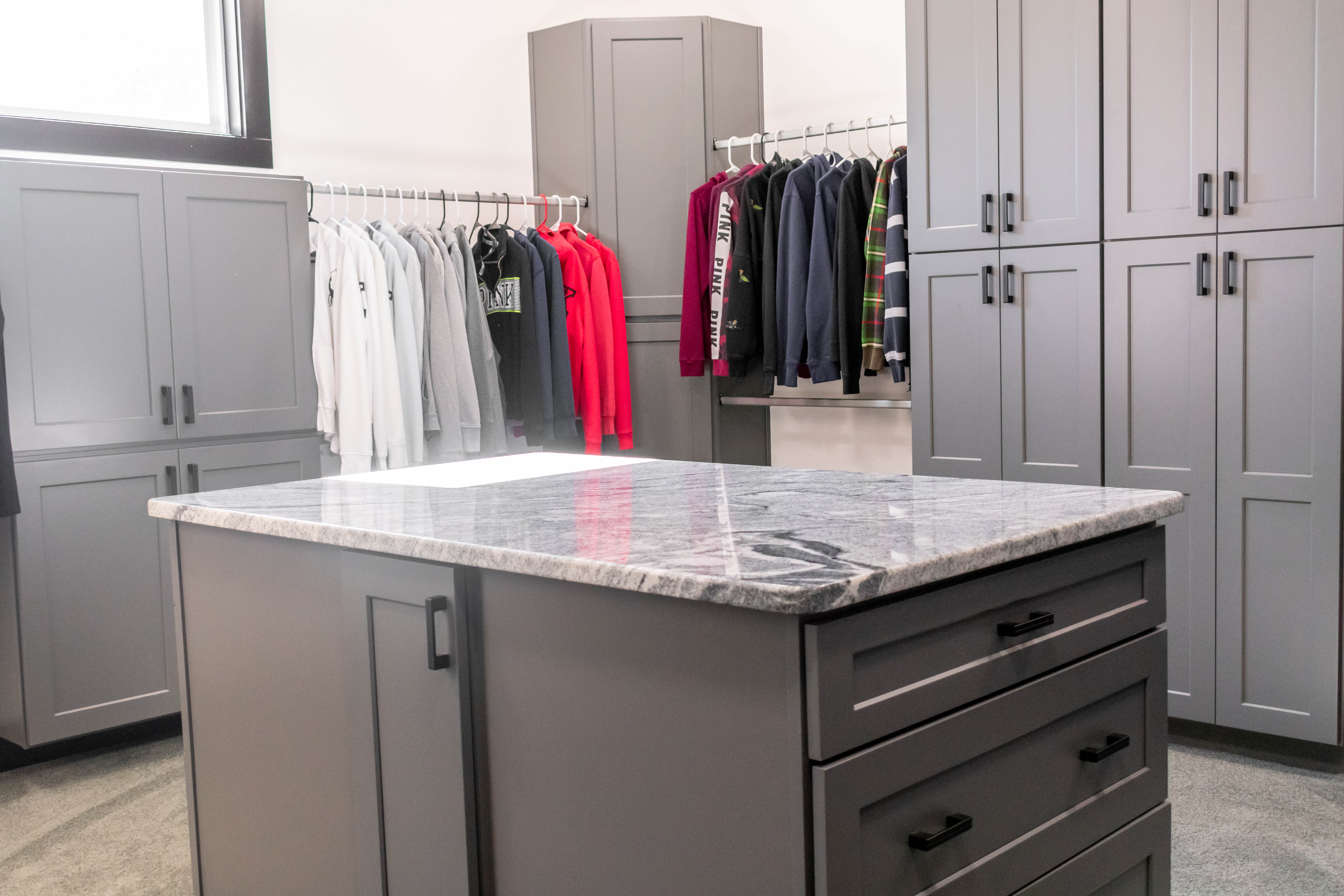 We topped this closet storage island with Viscon White Granite.